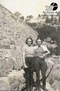 Photo of two women standing in front of Castlewood Canyon Dam