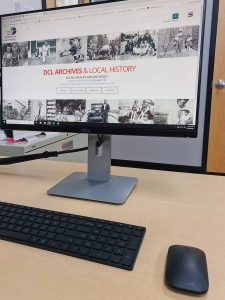 Image of a computer displaying the Archives & Local History website, archives.dcl.org