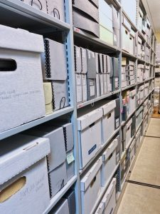 Image of archival boxes stored in the Archives & Local History vault.