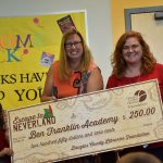 Ben Franklin Academy Principal Diana Simpson, center, and a 2nd-grade student representative received their summer reading school contest prize from DCL\'s Kristen Kallio.