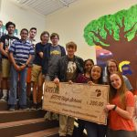 Student leaders from the STEM School in Highlands Ranch received their summer reading contest prize.