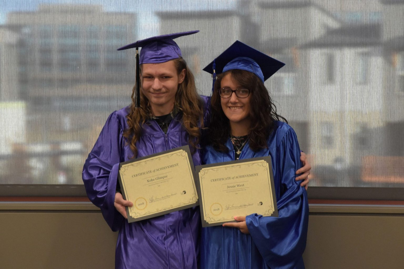 DCL celebrated two GED graduates in a December 2018 cap and gown ceremony. The 2019 graduation includes seven graduates, the most so far for the library.