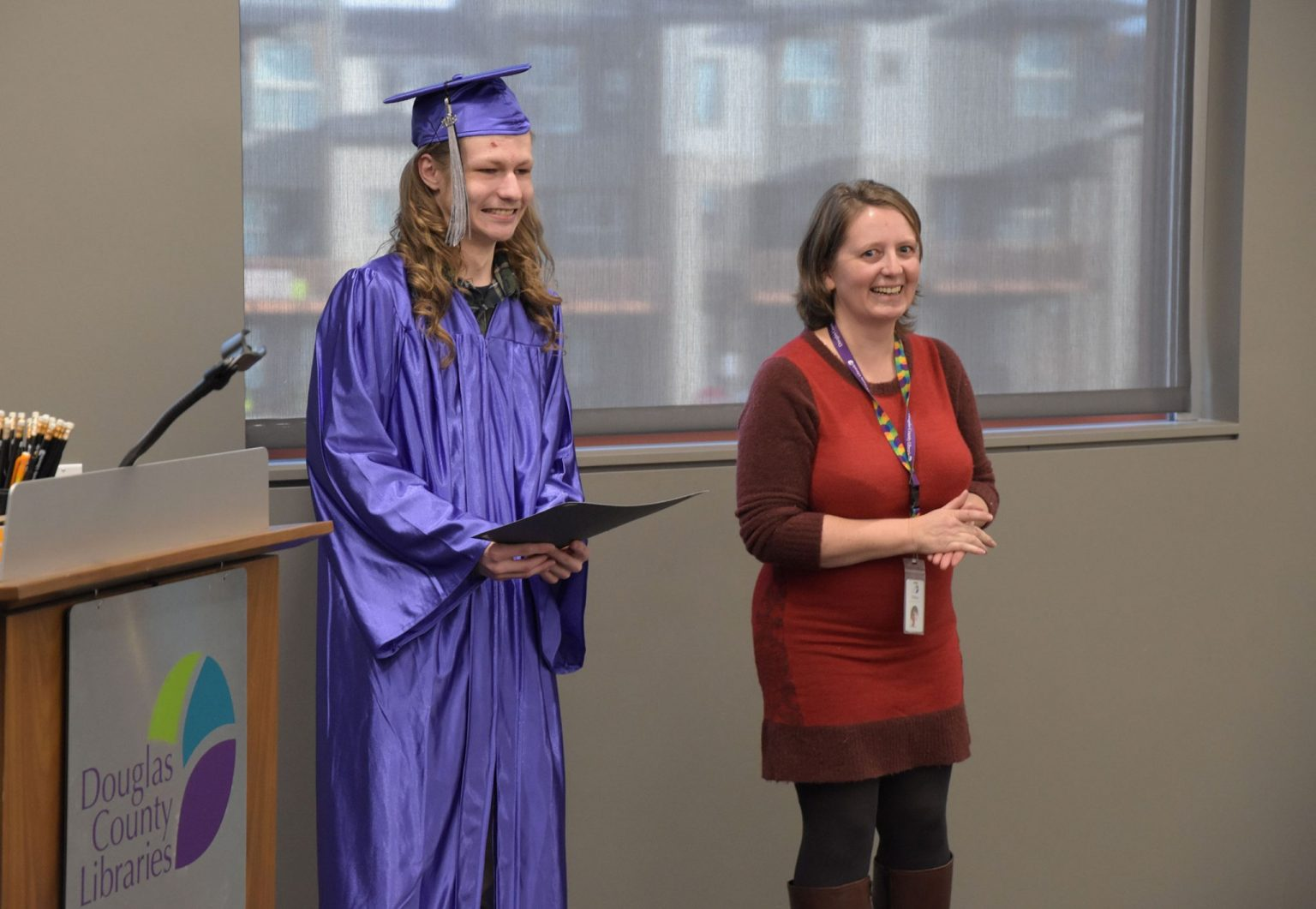 DCL Adult Literacy Specialist Tiffany Curtin recognizes the accomplishment of GED graduate Kobe Glimpse in 2018.