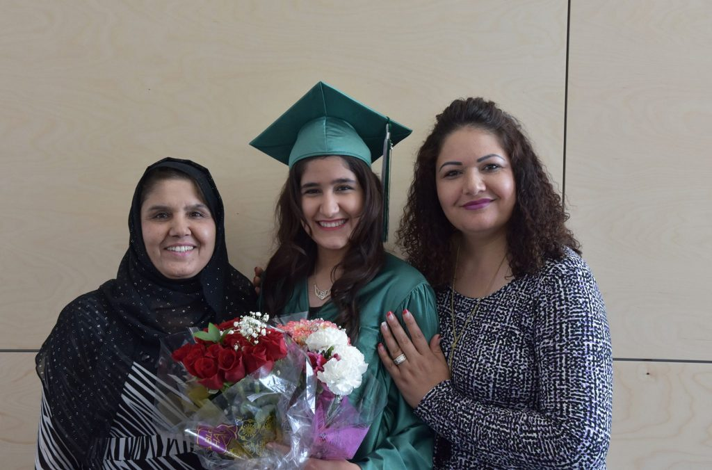 The high school equivalency graduation ceremony brings families together to celebrate.